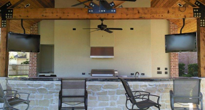 Black Metal Hanging Outdoor Mount Above Grey Stone