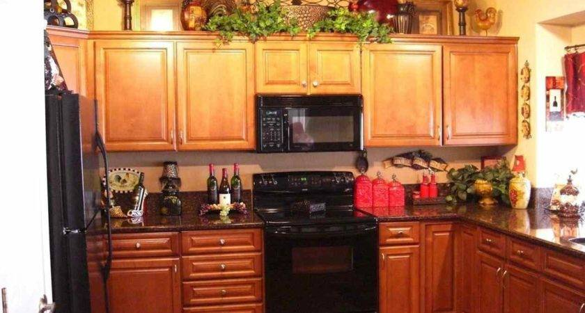 Decorating Above Kitchen Cabinets Tuscan Style Deductour