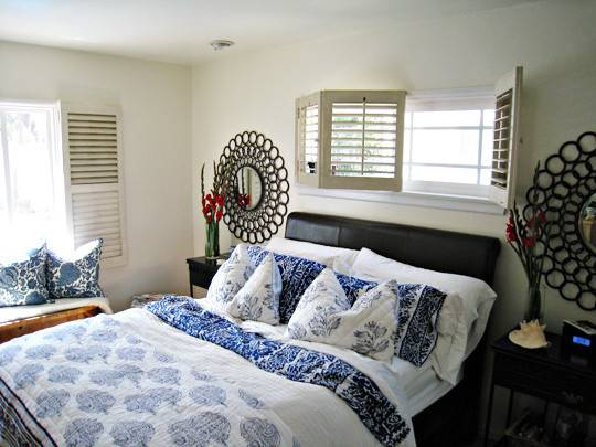 Master Bedroom Circles Mirrors Blue White Mixed Floral