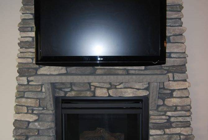 Mounted Stone Surface Above Fireplace