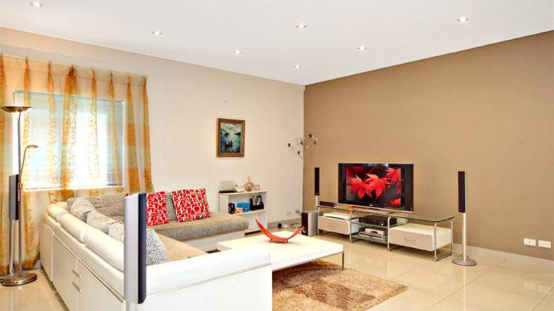 Open Plan Living Room Using Brown Colours Stone