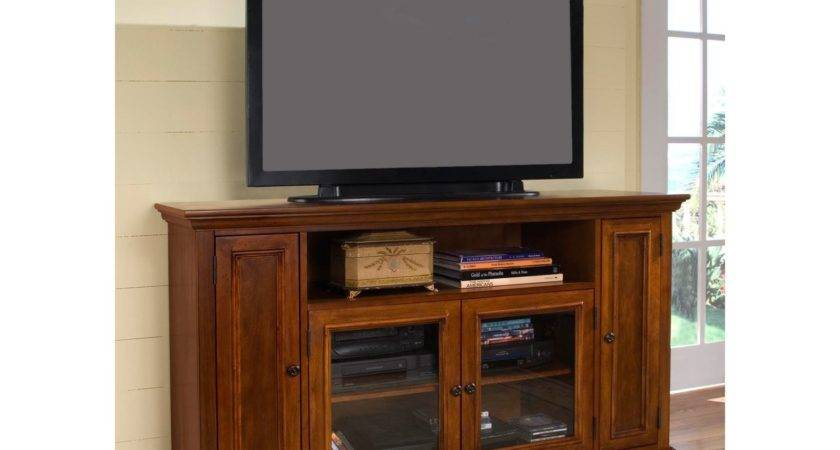 Rectangle Black Flat Screen Over Brown Wooden Cabinet
