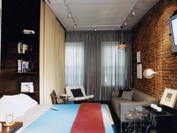 Tiny One Room Apartment Featuring Built Furniture