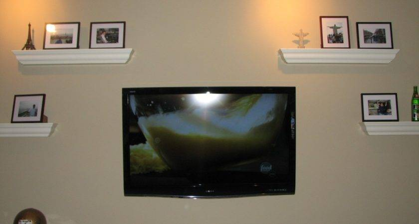 Wall Mounted Flat Screen Surrounded White Wooden