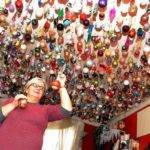 Woman Decorates Ceiling Christmas Baubles